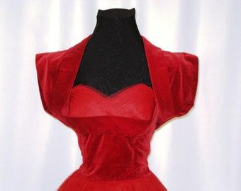1953 Red velveteen bridesmaid dress with taffeta and nylon netting. Very nice condition.