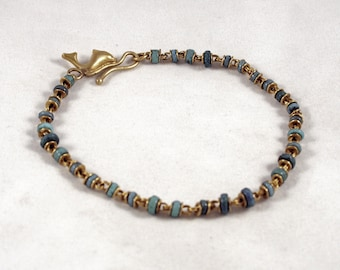 Pure gold bracelet with ancient egyptian glass and 750 gold dolphin closure