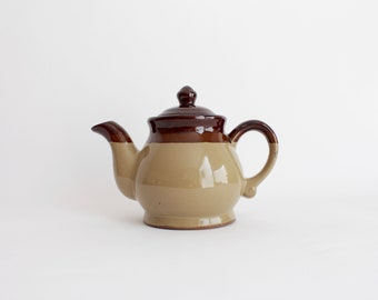classic ceramic teapot in three shades of brown