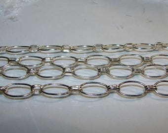 Chain 1 mm, round rings 14 by 8 mm round wire. Money first.