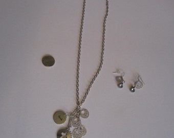 Silver pendant necklace and earring set by 'Patsy'