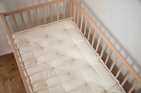 affordable new cribs earth super toxic lightweight by the crib non mattress lullaby blog