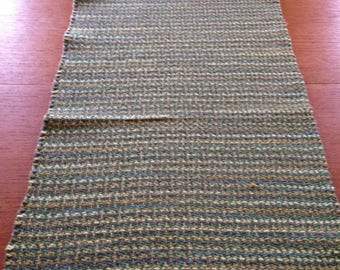 Handwoven table runner in four greens cotton