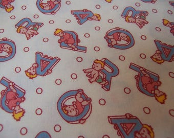 children sitting on letters cotton fabric