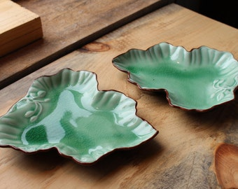 A Pair of Vintage Green Glazed, Brown Trim & Black bottom Ceramic Pottery Serving Leaf Dishes with Stem and Buds Relief