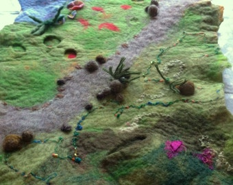 Hand felted play or story mat to spark a child's imagination.