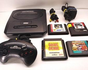 Sega Genesis Model 2 Console System Refurbished, Rebuilt Sega Controller, Sega AC, New AV Cord, Game Genie, 3 Games inc Street Fighter 2