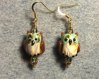 Brown and green lampwork owl bead dangle earrings adorned with green Czech glass beads.
