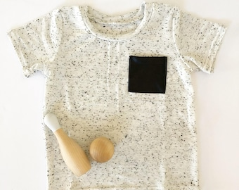 White and black speckled t-shirt with pleather pocket