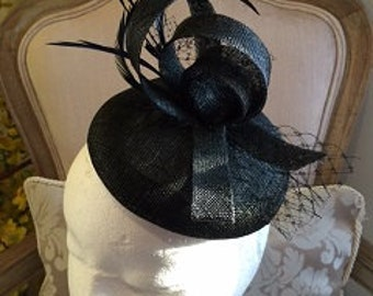 Beautiful black fascinator base with black loops, netting and feathers. Gorgeous on!