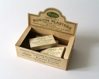 Vintage pharmacy store display with bunion plaster boxes 'Portia'