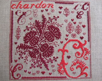C as two-tone red Thistle embroidery