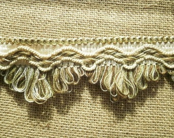 "Has fringe trim ""buckle"", acrylic, off-white, embroidered background in shades green and Brown, 5.7 cm wide"