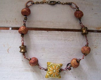 Hiske .... A unique recycled necklace in vintage materials and color.