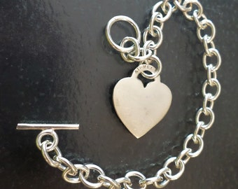 Sterling Silver 925 Stamped, ATI Signed, Made in Mexico, 19.9 grams Link Bracelet with Heart Charm.