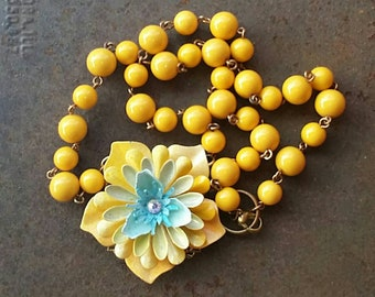 A Cheerful Yellow Multiple Petaled flower Necklace  from Wendy Baker