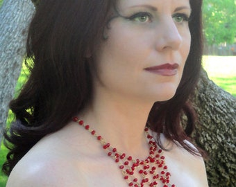 Red Velvet and Gold Necklace: Red Velvet Crystals on Gold Wire in Draped Chain Pattern