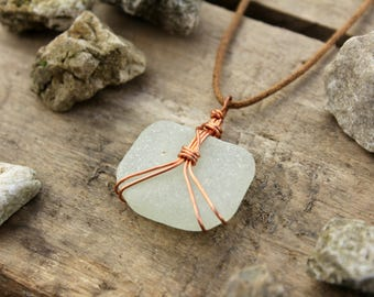 Frosted white sea glass necklace with woven copper wire work. 100% handmade. Glass discovered along the Jurassic coast, England.