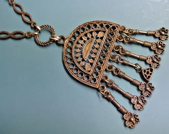 Vintage 1960s India handmade altered metal pendant necklace with metal chain and 7 hanging charms