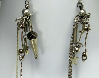 Leah, unmatched, silver flowers, cones, stars,  dangle earrings.  sculptural, handmade, contemporary. steampunk
