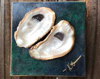 Oyster shell art on painted canvas