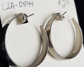 Earrings- 1990's hoop studs silver in color.