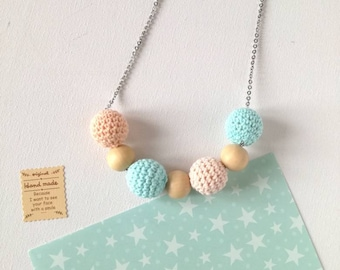 Natural wood necklace with crocheted cotton balls