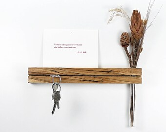 Key bar beech topped with test tube vase test Rube vase key board