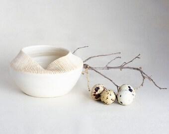 White collection pot