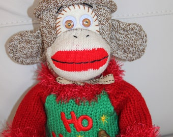 Rockford Red Heel Christmas Sock Monkey Wearing Red Green Sweater with Bell