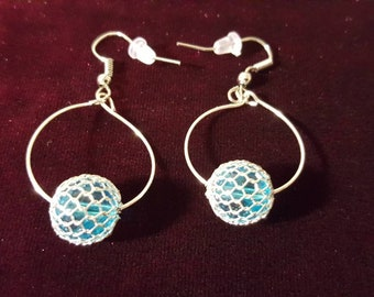 Handmade hoops with ice blue center bead
