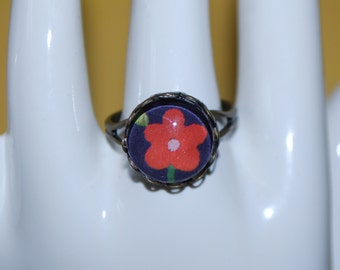 Adjustable small comic red flower ring