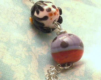 Necklace with Lampwork Glass doll.