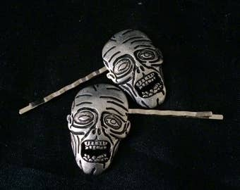 Set Of 2 Hair Pins Featuring Silver Metal Zombie Faces