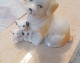 Beige and Tan Dogs  with Black Trim Dog Figurine