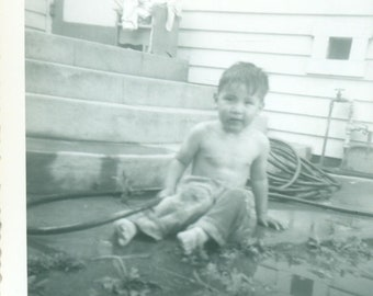 Getting Muddy Little Boy Playing in Dirt Hose Yard Mud Puddle 1950s Vintage Photograph Black White Photo