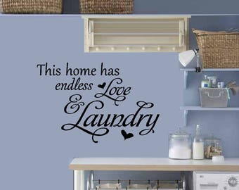 This home has endless Love and Laundry: and Clothes Hanging Wall Decal