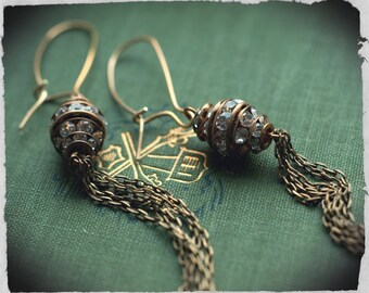 Vintage rhinestone bicone beehive beads, aged brass and crystal beads with antique brass chain tassel, long earrings, shoulder dusters.