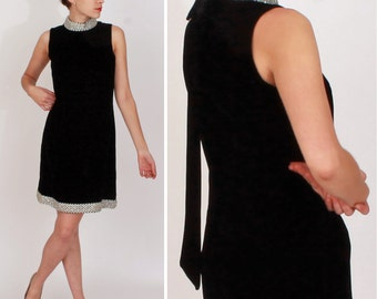 Vintage 1960s Sleeveless Black Velvet Mod Shift Dress with Sparkly Silver Trim and Long Back Bow | Small