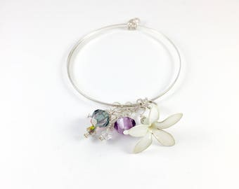 Bangle. Silver Bangle with White resin flower and Swarovski crystals.