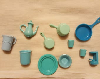 1980s Barbie plates, cups, pots, and pans -- including what look as if they were tiny versions of Fiestaware