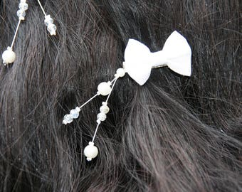 Ornaments with white bow and pearls bridal hair