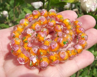 2 BEADS, FACETED RONDELLE ORANGE LAMPWORK A. 10 X 7 MM.