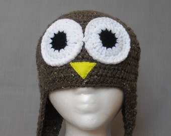 crocheted brown owl winter hat with earflaps and braided tassels
