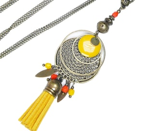 Long pendant necklace, mustard pompom, orange beaded, brass jewel