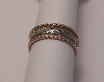 Sterling silver floral patterned band ring with Two14 karat gold filled stackers