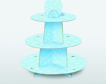 Sky blue small cakes or cupcake display with polka dots