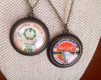 Vintage cotton reel label pendants /choose one / dewhursts sylko / upcycled cotton reel jewelry / bronze tone pendant / sewing theme jewelry