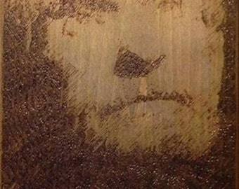 A pyrograph portrait of psychonaut Timothy Leary.