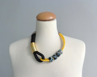 Black gold yellow green statement necklace